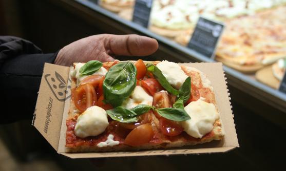 Porción de pizza al corte de Papizza