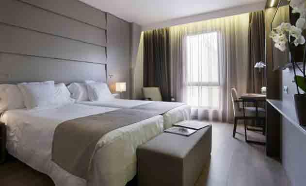 Habitaci´pn reformada del hotel América de Barcelona