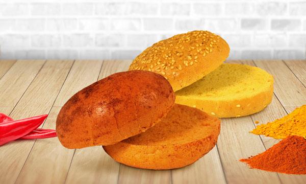 Panes de hamburguesa de Ibepan con un toque a paprika (izda.) y curry (derecha)