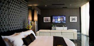 La elegante habitación del hotel boutique Hugo's, vestida por Resuinsa