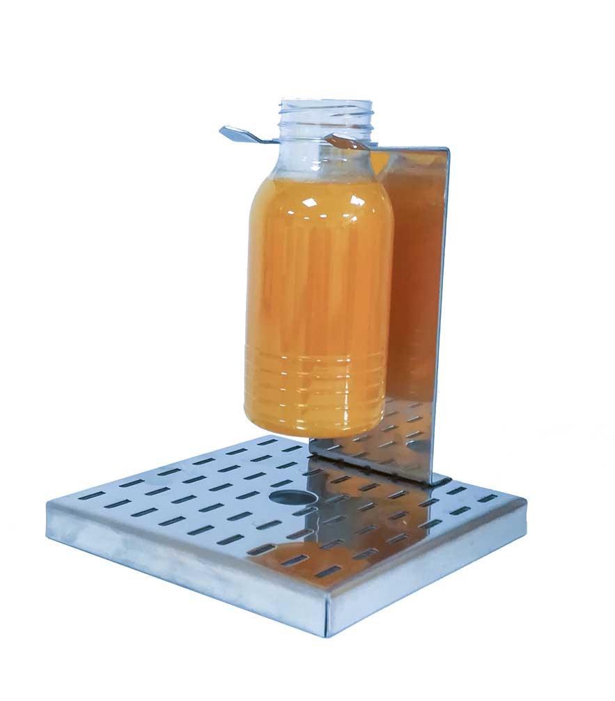 Accesorio para el llenado de botellas de zumo de Frucosol